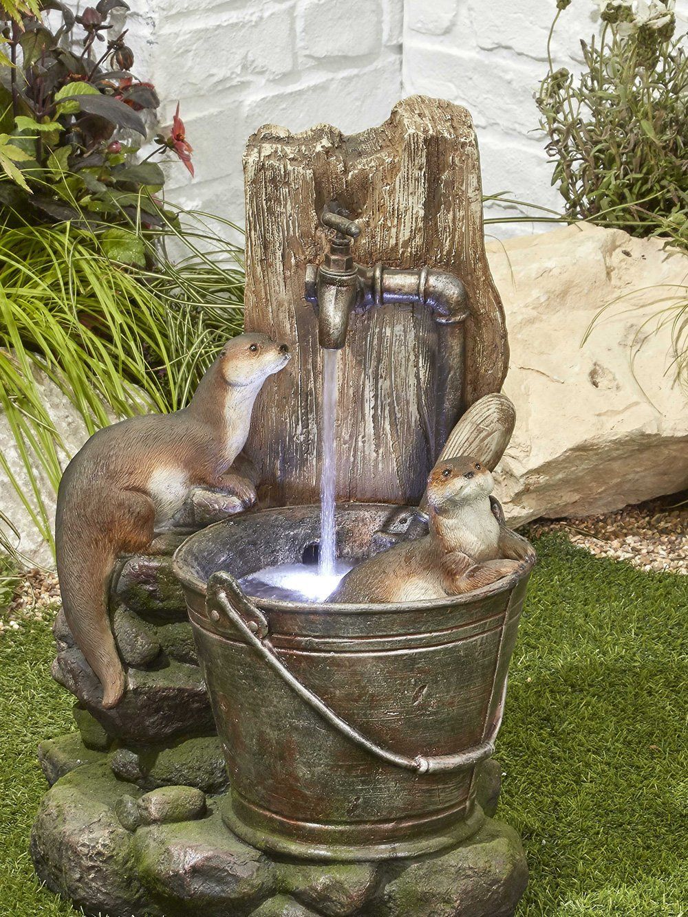 Playful otters water feature waterfeatures2go for Water features